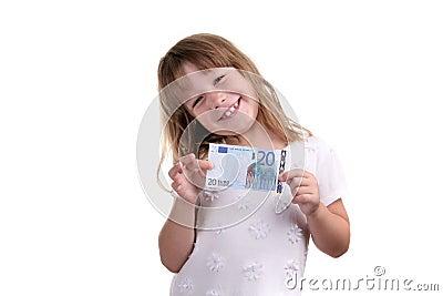 La fille avec le billet de banque dans des mains