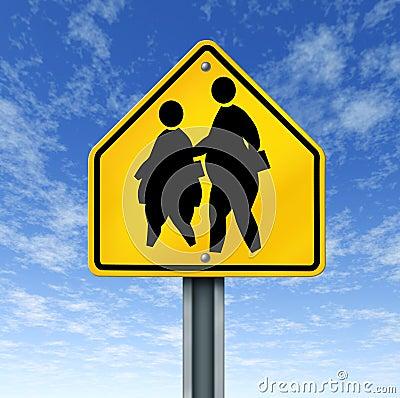 La grosse école obèse badine le signe de rue