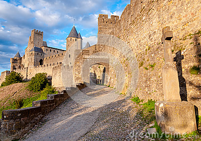 La Porte De Aude and cross at late afternoon in Carcassonne
