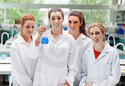 Lab partners posing with a flask