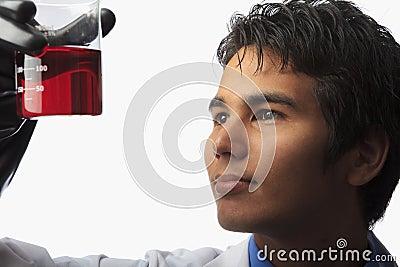 Lab technician holding a beaker