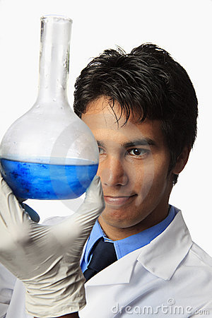 Lab technician holding a flask