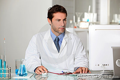 Lab technician studying results on a computer