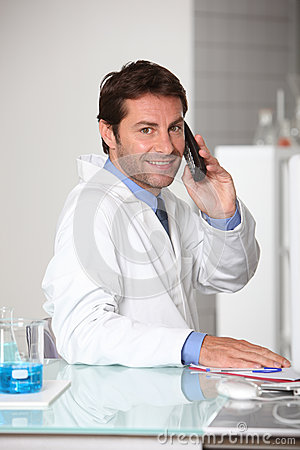 Lab technician on the telephone