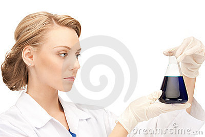 Lab worker holding up test tube