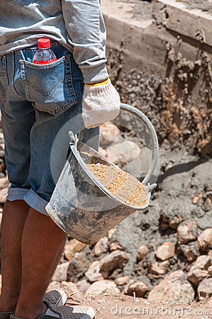 Labor carry sand in cistern for construction