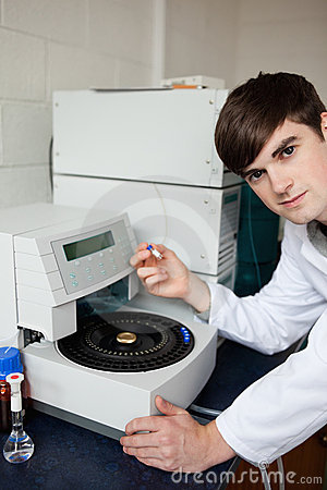 Laboratory assistant using a centrifuge