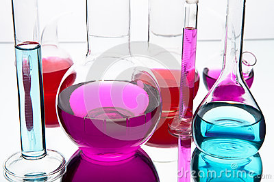 Laboratory glassware with colorful chemicals