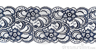 Lace trim ribbon over white. Fabric. Closeup