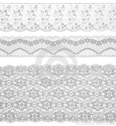 Lace trims ribbon over white. Set of fabric.