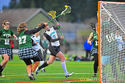 Lacrosse girls shot block night game Editorial Photography