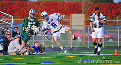 Lacrosse Player knocked out of bounds Editorial Stock Image