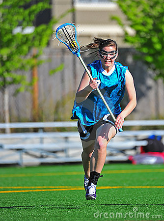 Lacrosse Running to the camera with the ball
