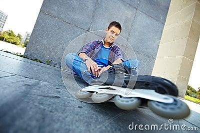 Lad on roller skates