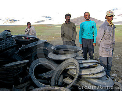 LADAKH, INDIA: Tires workers Editorial Photography