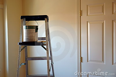 Ladder with paint can and brush