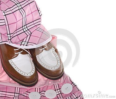 Ladies golf shoes and plaid clothing