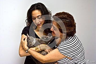 Ladies holding cat