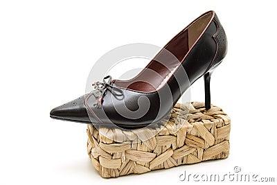 Ladies shoe on basket