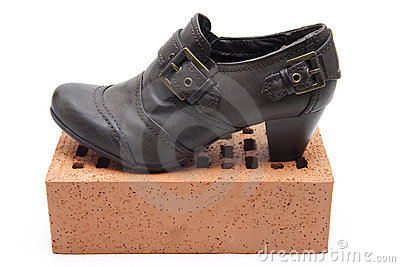 Ladies shoes on brick stone