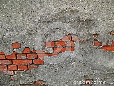 Ladrillos que revelan de una pared del cemento imagen de - Paredes de cemento ...