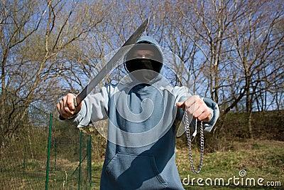 Ladrón con un machete