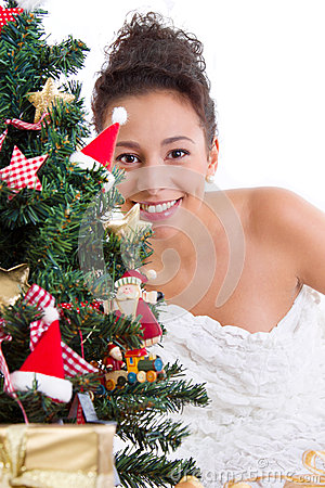 Lady behind christmas tree