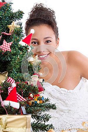 Lady behind christmas tree
