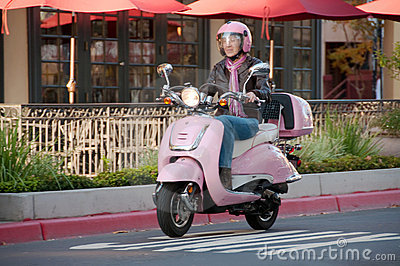 Lady biker on pink scooter