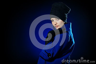 Lady  in a blue topcoat