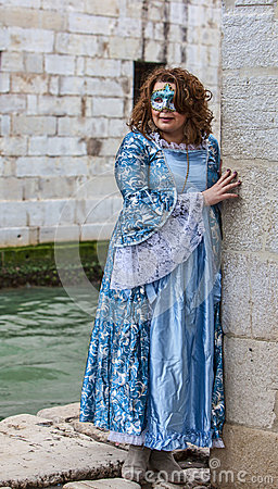 Lady Disguised in a Blue Costume Editorial Image