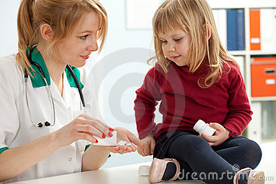 Lady doctor with little girl in exam room