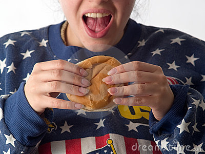 Lady eats hamburger
