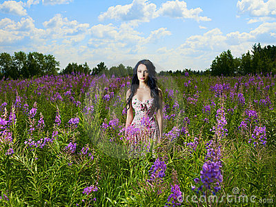 Lady in a flower meadow