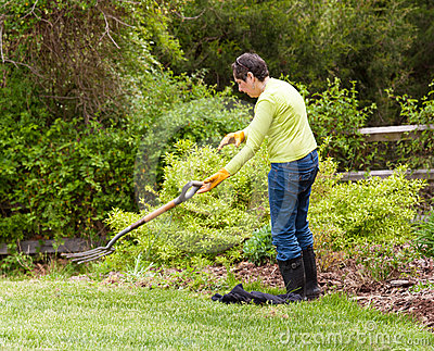 Lady gardener throws away fork in frustration