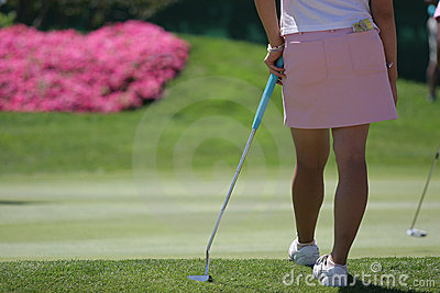 Lady golf putting