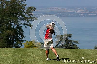 Lady golf swing at Leman lake