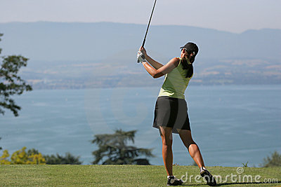 Lady golf swing at Leman lake