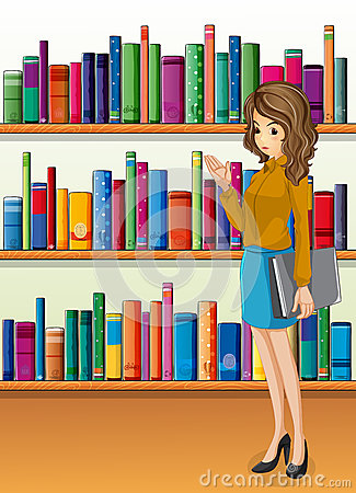 A lady holding a binder standing in front of the wooden shelves