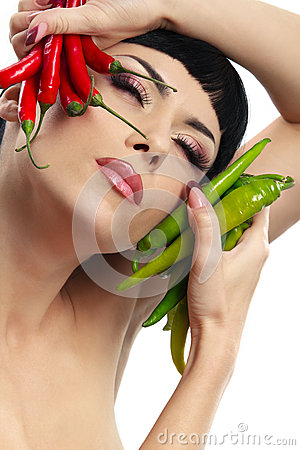 Lady holding hot chilli peppers