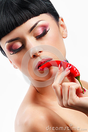 Lady holding red chilli peppers
