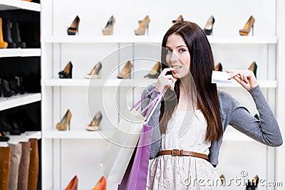 Lady keeps credit card in footwear shop