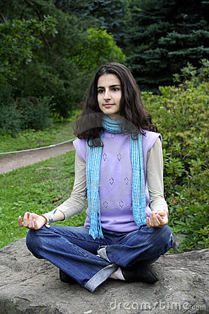 Lady in lotus position yoga