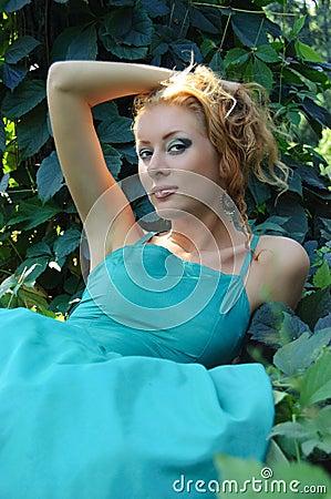 Lady lying on grass
