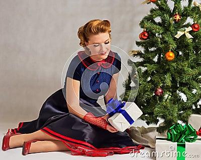 The lady next to Christmas tree