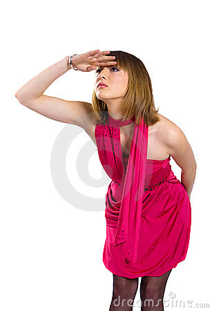 Lady in a pink dress looks into the distance