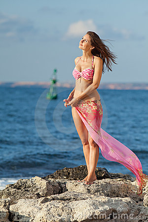 Lady in pink swimwear at the sea