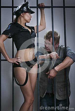 Lady police officer guards the offender in prison