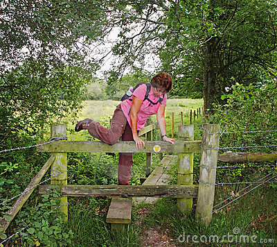 Lady Rambler climbing over a Stile
