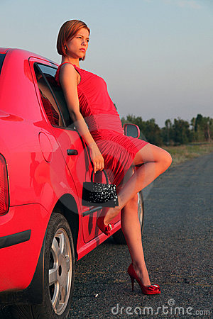 Lady in red and car